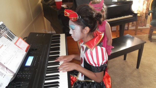 Student having fun at the Fall Fun Piano Party, 2014
