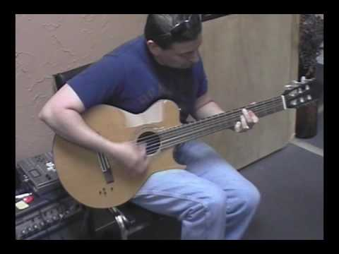 Jimmy Cruz on the Greg Bennett Thinline Electric Nylon