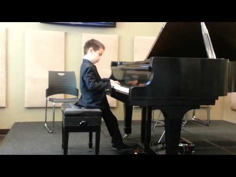 6 year old pianist performing Down by the Riverside and Fisherman's song.